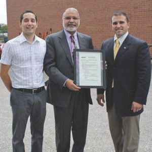 Compact Mould's executive vice president Gaston Petrucci, MPP Dr. Kuldip Kular and Gus Kokkoros of Icarus Power Generation pose with plauqe at the official August start-up in Brampton.