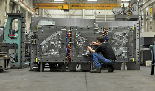 Checking a mold before shipping at Cavalier Tool & Manufacturing Ltd.