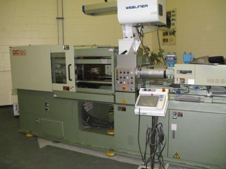 A 120-ton Nissei two-shot injection molding machine.