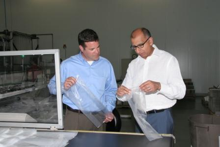 Polykar's David Andrews (left) and Amir Karim (right) examine gusseted bags.