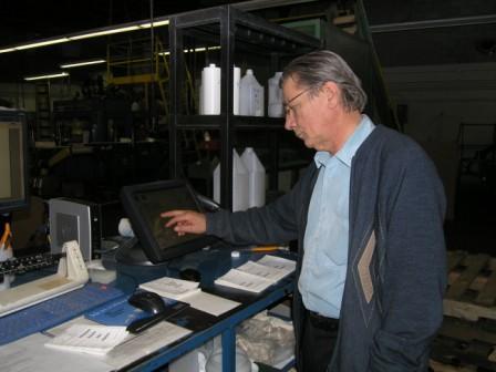 B&C Plastics president Cory Gambon, Sr. reviewing real-time production data.