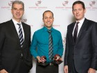 Dave Kroetsch, CEO and co-founder of Aeryon Labs Inc. (centre) with his two Ontario Export Awards, including the top award for Exporter of the Year. He is joined by (left) Frank Venturo, senior vice-president and country head of business banking with HSBC Canada, and (right) Daniel Leslie, senior vice-president and head of corporate banking for Canada at HSBC. HSBC was the platinum sponsor of the Ontario Export Awards.