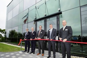 Cutting the ribbon at the opening, with managing partner Michael Hehl (third from left) and Bill Carteaux (fourth from left).
