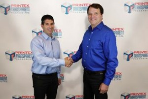 David Heller, president of Printex Packaging Corporation, and David Dennison, president of Transparent Packaging, seal the deal.