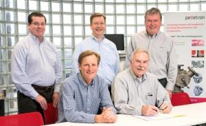 Pictured left to right are, in front: Chris Keller, IPEG CEO and Heinz Schneider, Pelletron president; in back: Kirk Winstead, IPEG COO, John Erkert, IPEG CFO and Paul Wagner, Pelletron vice president.