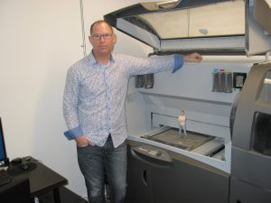 Michael Gossack and the company's ProJet 660 Pro 3D printer.