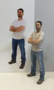 The real Jason Priestley in the photo backdrop and a 3D-printed model in the forefront.