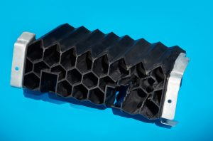 Promogroup's plastic/metal hybrid floor rocker reinforcement.