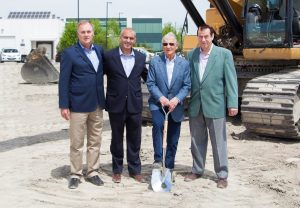 Harold Luttmann (left) and Robert Schad (third from left) at the groundbreaking ceremony for Athena's 150,000-square-foot facility in Woodbridge, Ont., in June 2014.